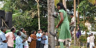 Woman trains to climb coconut trees in Kerala
