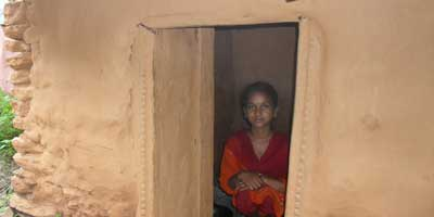 Kamala Vishwarkarmas sits inside her goth, where she has been staying alone during the week of her monthly period. 'Chhaupadi', the Nepalese practice of segregating menstruating women from their houses and men, was outlawed by Nepal's supreme court in 2005