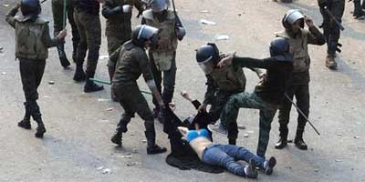 Egyptian soldiers beating and dragging a young woman during clashes in Tahrir Square. Her image has become the latest icon of the revolution. Photo: Reuters