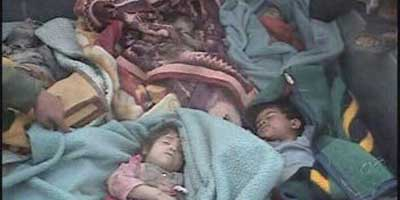 Photo alledgedly taken by a resident of Ishaqi on March 15, 2006, of bodies Iraqi police said were of children executed by U.S. troops after a night raid there.