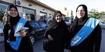 Libyan female candidates Majdah al-Fallah (L) and Hanan Rashed (R) campaign for the Justice and Construction Party, the political arm of the Libyan Muslim Brotherhood, in the Hay Andalus suburb of Tripoli, June 28, 2012. Libyans head to the polls on July 7 to elect a national assembly in the nation's first election in a generation almost a year after ousting Muammar Gaddafi in a NATO-backed rebellion.