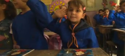 Girl salutes at Syrian school: Image from BBC News report