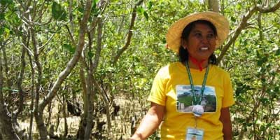 Lucena Duman readies for her tour-guide role on Ang Pulo island. Photo: Marwaan Macan-Markar/IPS.
