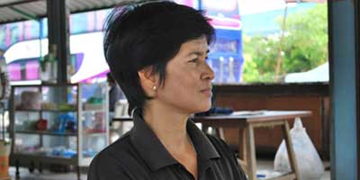 Jomkwan Sawekjinda is demanding those behind the murder of her activist husband Thongnak are brought to justice. (Photo: Simon Roughneen)