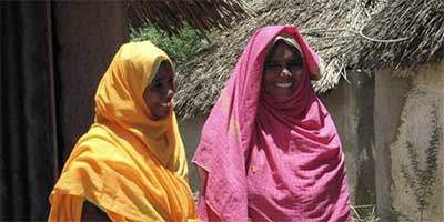 Meriam Mohamed Omar (R) stands with her daughter in the village of Hagaz, some 100 km (63 miles) from Asmara, in this May 7, 2007 file photograph. (Reuters/Jack Kimball)