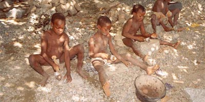 Beninese children crushing stones into gravel at a quarry at Tchatchegou, north of the capital Cotonou, June 2005.