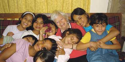 Olga Murray and children in Nepal