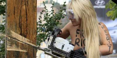 Femen-activist-with-chainsaw