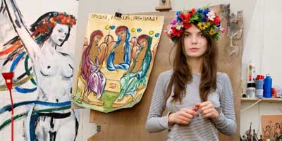 Femen activist Oksana Shachko is a professional icon painter and lives in a run-down studio apartment in Kiev with greenish mold on the ceiling. | Photo: Valeria Mitelman/ DER SPIEGEL