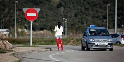 A prostitute waits for customers on a road in La Jonquera, on the border with France and Spain