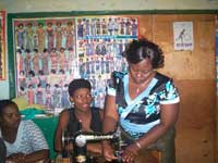 Bahati-teaching-sewing