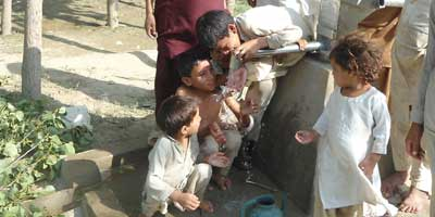 Kids-at-water-pump