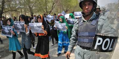 "Afghan Young Women for Change activists hold placards that read ""Where is justice?"" 