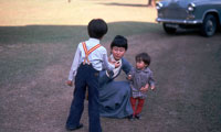 Suu Kyi playing with sons