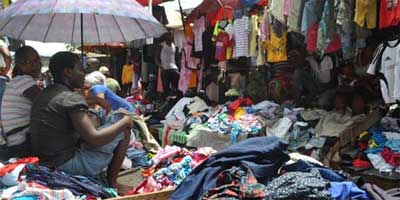 A third of all globally donated clothes end up in sub-Saharan Africa via wholesale rag houses, where they end up lining the streets or small boutiques such as this market at Katangua in Nigeria. | Photo: Monica Mark | Guardian