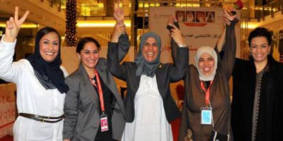 Al Beloushi (center) celebrates with Sawsan (left), Amal Abul (Head of City Centre polling station), Somaya and Ebtisam.