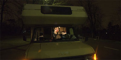A prostitute working from a campervan in the Bois de Boulogne. Photo: Amy Toensing/Getty Images