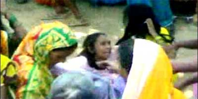 'Witches' being abused by a mob in India in 2010