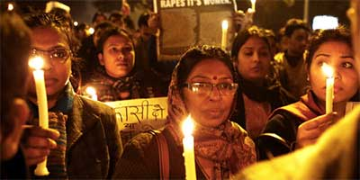 Indian protesters hold candles and block a road during a December rally in New Delhi after the cremation of a woman who was gang-raped and died of her injuries two weeks later. (Andrew Caballero-Reyonlds / AFP/Getty Images)