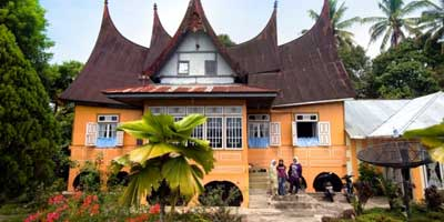 A traditional Minangkabau home, or rumah gadang. This particular building houses three generations of women and their families.
