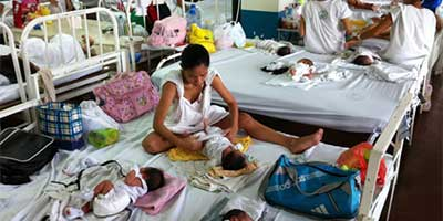 Mothers and their children at the maternity ward of the Jose Fabella Memorial Hospital, a government hospital in Manila, Philippines.