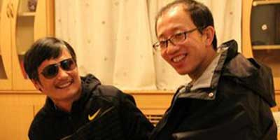 Chen Guangcheng and fellow activist Hu Jia in a photo released by Mr Hu's wife Zeng Jinyan