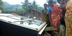 Forest women in Anantagiri forest in the south-east of India check out their solar dryer. | Photo: Stella Paul/IPS.