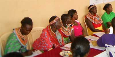 Local Samburu women listening attentively