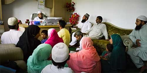 Visitors wait to consult Sheikh Ghulam Rasool Hami, a faith healer in Shaadipora, about 20 kilometers (12 miles) from Srinagar.