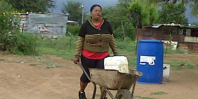 South African woman fetching water