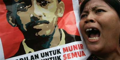 An Indonesian protester shouts slogans as she holds a poster of Munir Said Thalib during a demonstration in Jakarta September 7, 2007, the third anniversary of his assassination. REUTERS/Dadang Triv