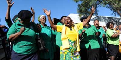 Members of the ANC Women's League and other activists vent their anger outside court. | Photo: Chris Collingridge  INLSA